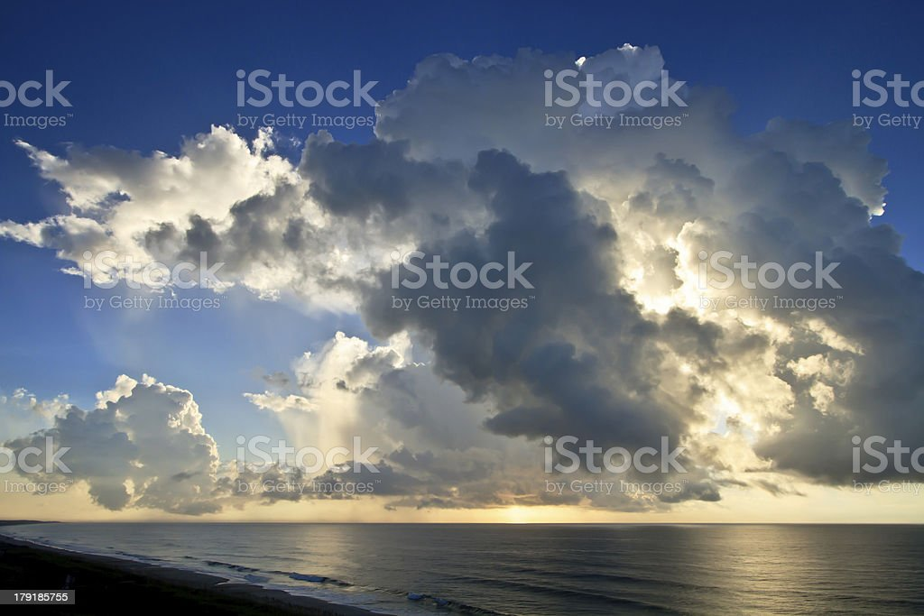Clouds over a Calm Ocean in the Morning royalty-free stock photo