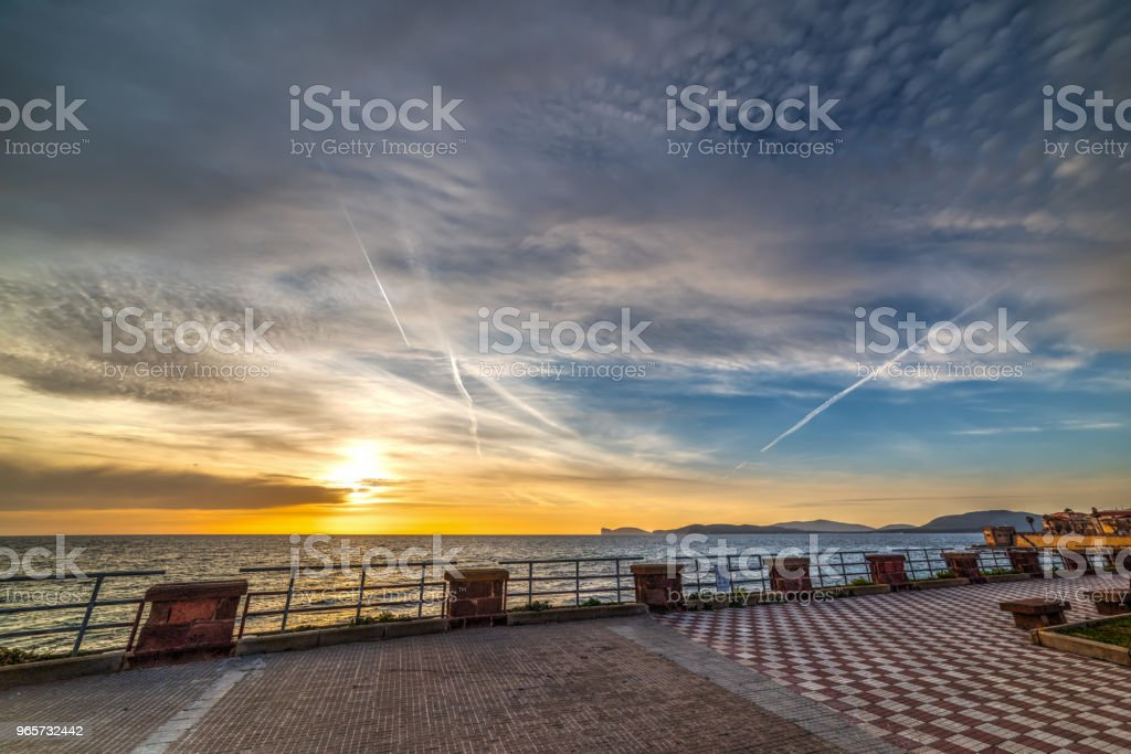 Clouds over Alghero seafront at sunset - Royalty-free Alghero Stock Photo
