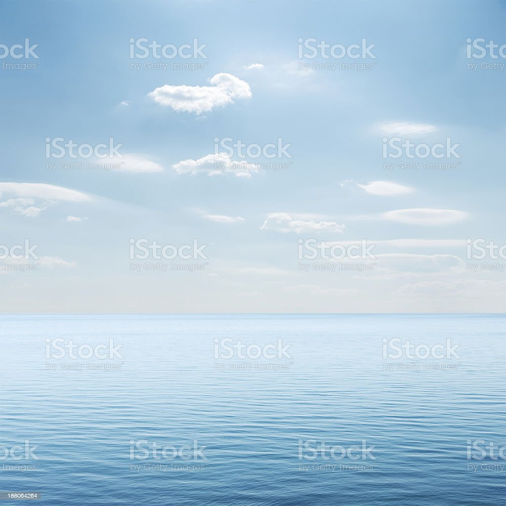 clouds over blue sea stock photo