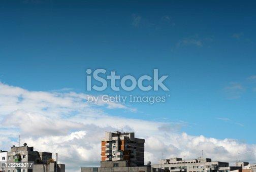 cloudscape over urban scene