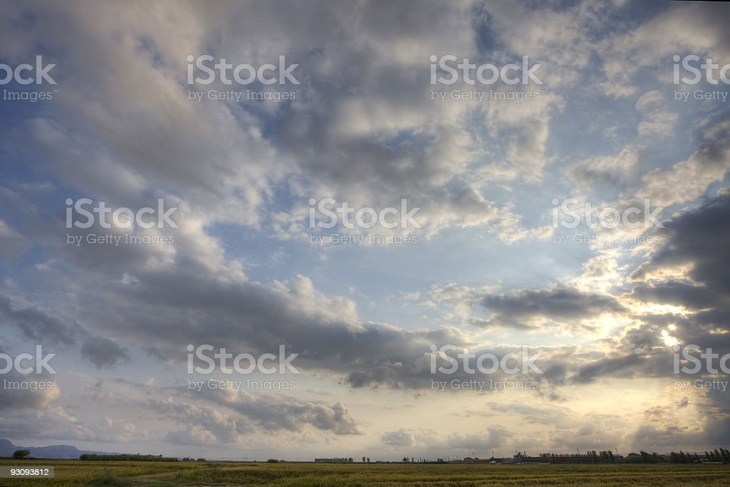 clouds over farm field royalty-free stock photo