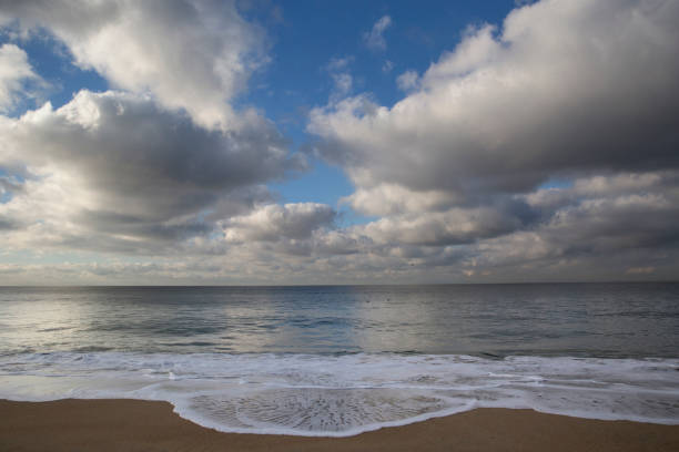 Clouds Over Huntington Beach clouds over Huntington Beach with waves coming to the shore jude beck stock pictures, royalty-free photos & images