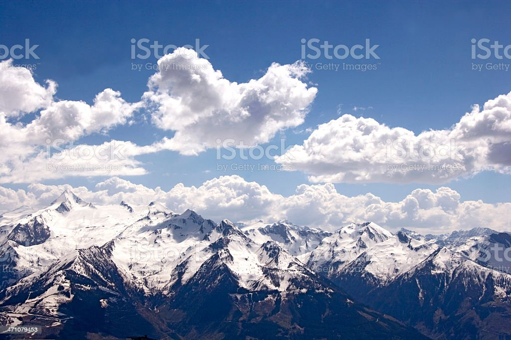 clouds over mountain range stock photo