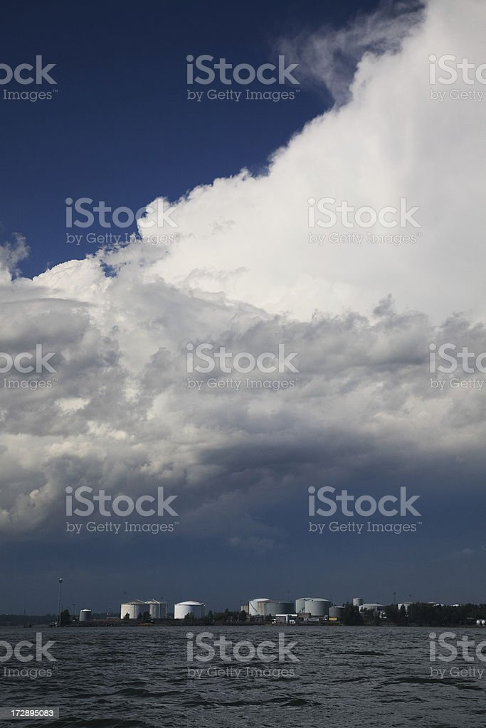 Clouds over oil industry stock photo
