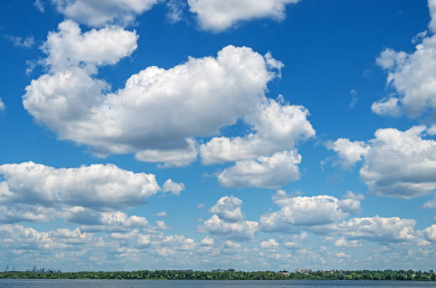 clouds over river - distant stock pictures, royalty-free photos & images