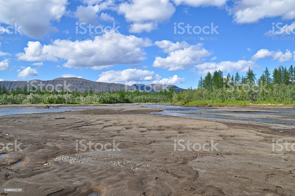 Clouds over river shoals. stock photo