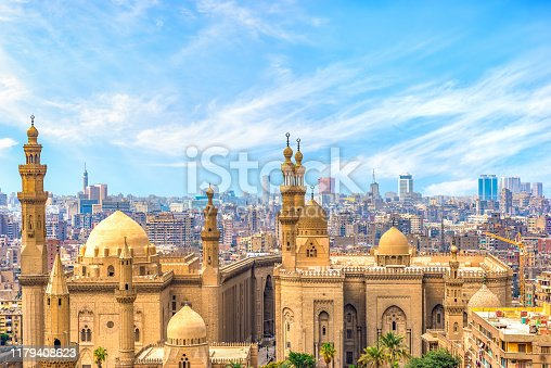 Clouds over majestic ancient Sultan Hassan Mosque in Cairo, Egypt