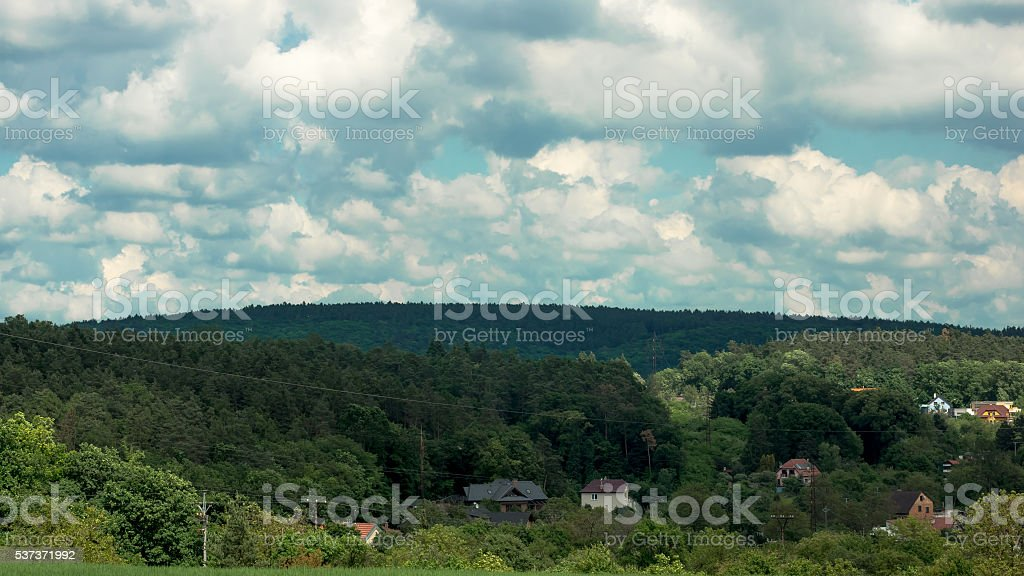 Clouds over the houses in the valley stock photo