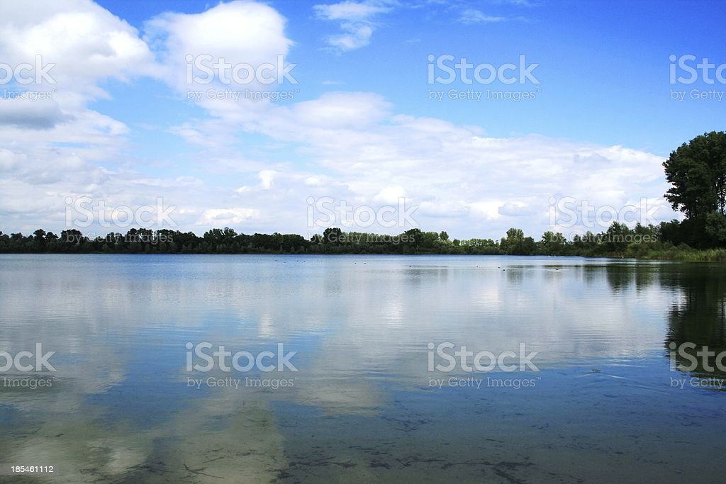 clouds over the lake royalty-free stock photo
