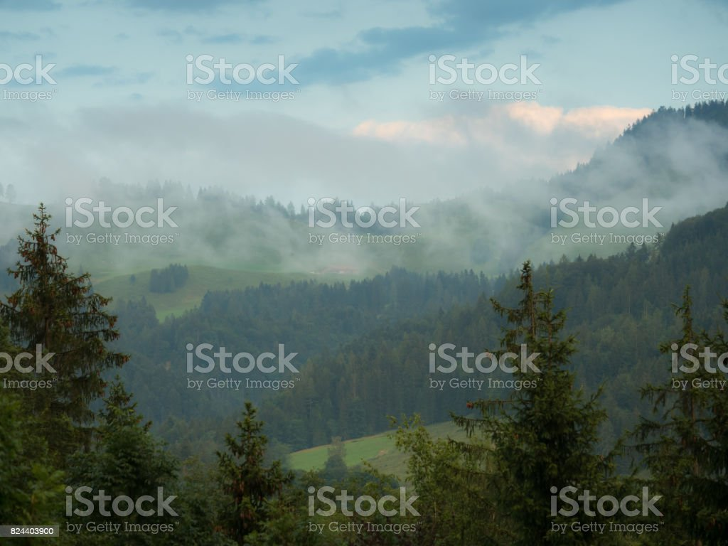clouds over the mountains and forest stock photo
