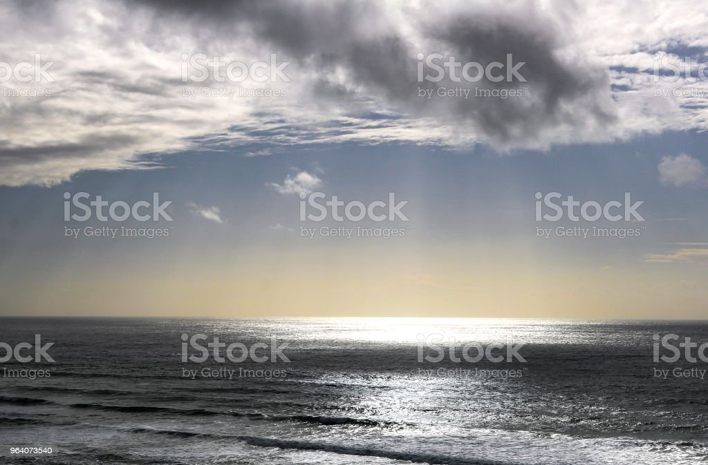 Clouds over the Ocean with Sunlight - Royalty-free Beach Stock Photo