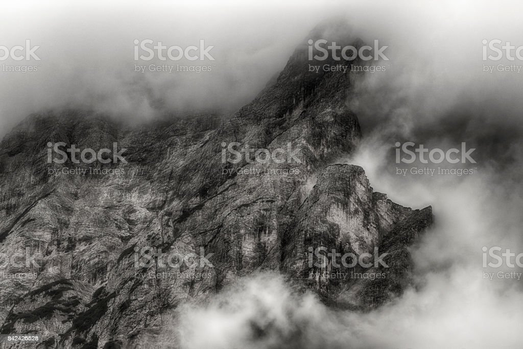 Clouds over the top of mountain stock photo