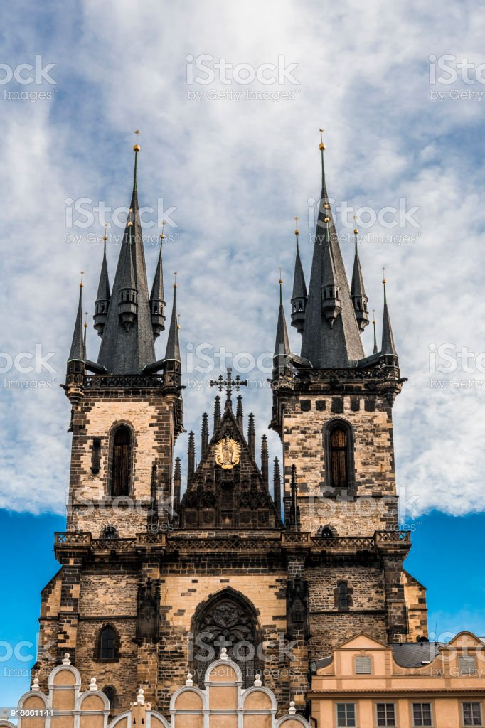 Clouds over the Tyn temple stock photo