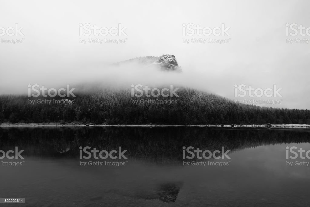 Clouds passing before Rattlesnake Ledge stock photo