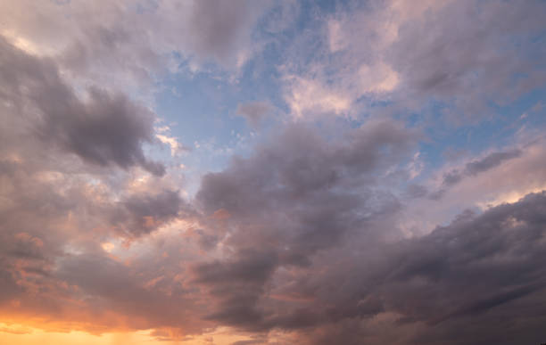 Clouds Storm Clouds at Sunset with an orange sky overcast stock pictures, royalty-free photos & images