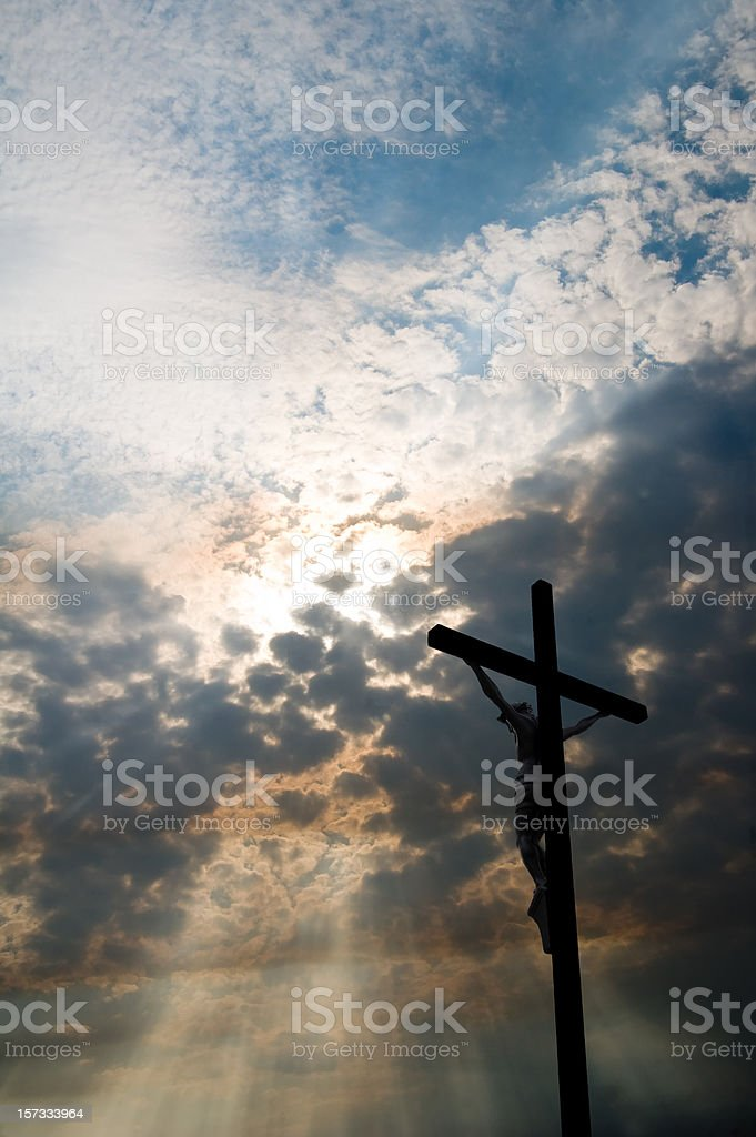 Clouds, Rays of Sun, and Crucifix royalty-free stock photo