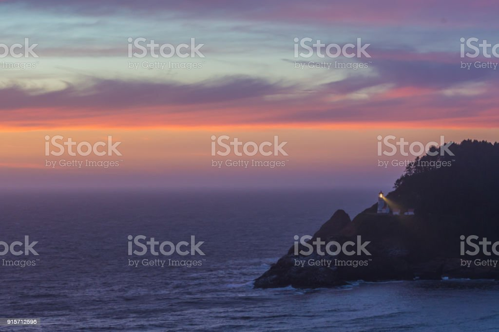 Clouds Reflect Sunset Over Heceta Head stock photo