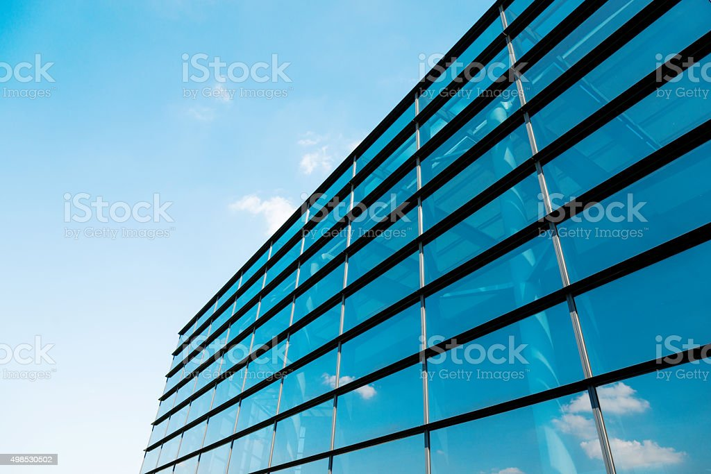 Clouds reflected on glass office building stock photo