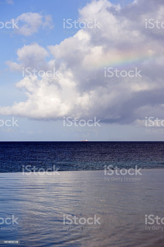 clouds reflecting in a quiet turquoise caribbean sea royalty-free stock photo