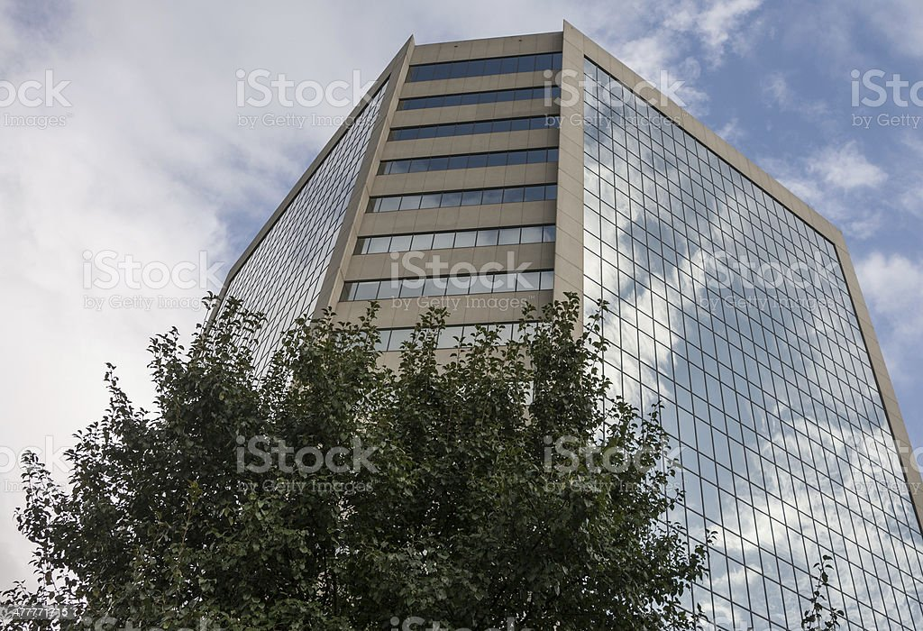 Clouds reflecting on building royalty-free stock photo