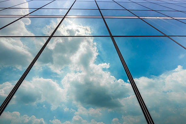 Clouds reflection in office tower stock photo
