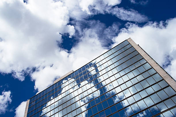 Clouds reflections on office building. stock photo