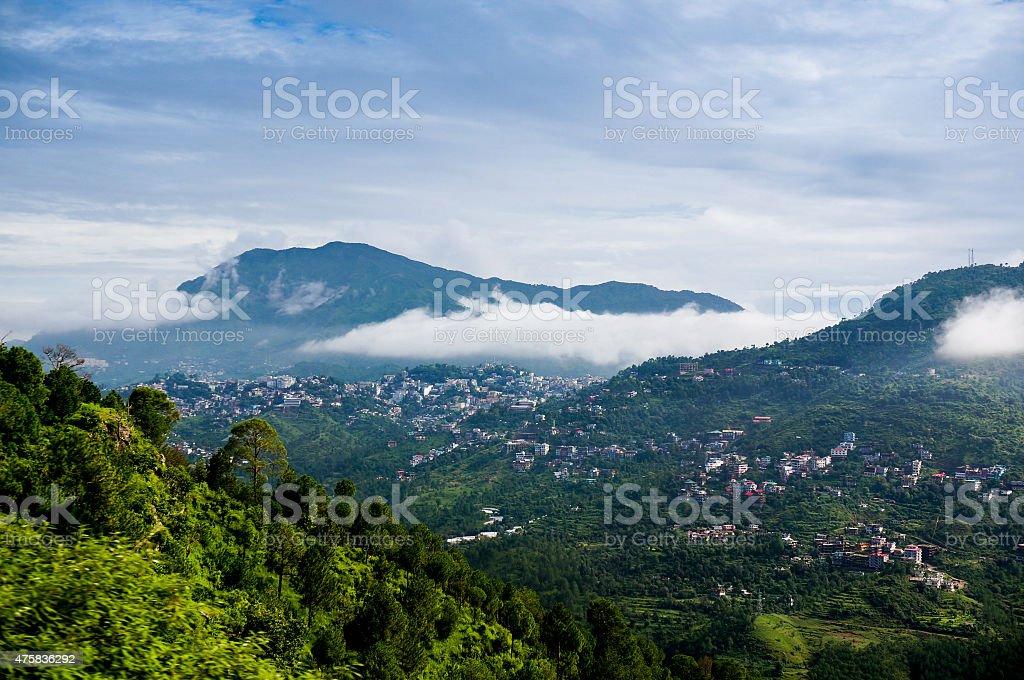 Clouds rolling between hills of himachal stock photo