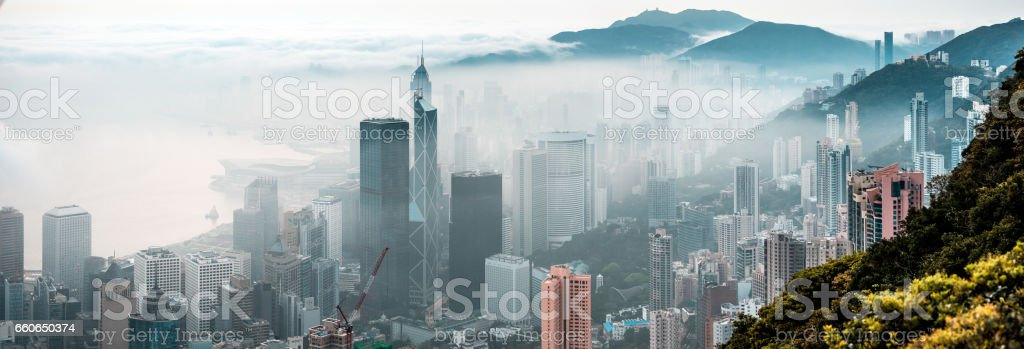 Clouds rolling over Hong Kong Victoria Harbor at misty season stock photo