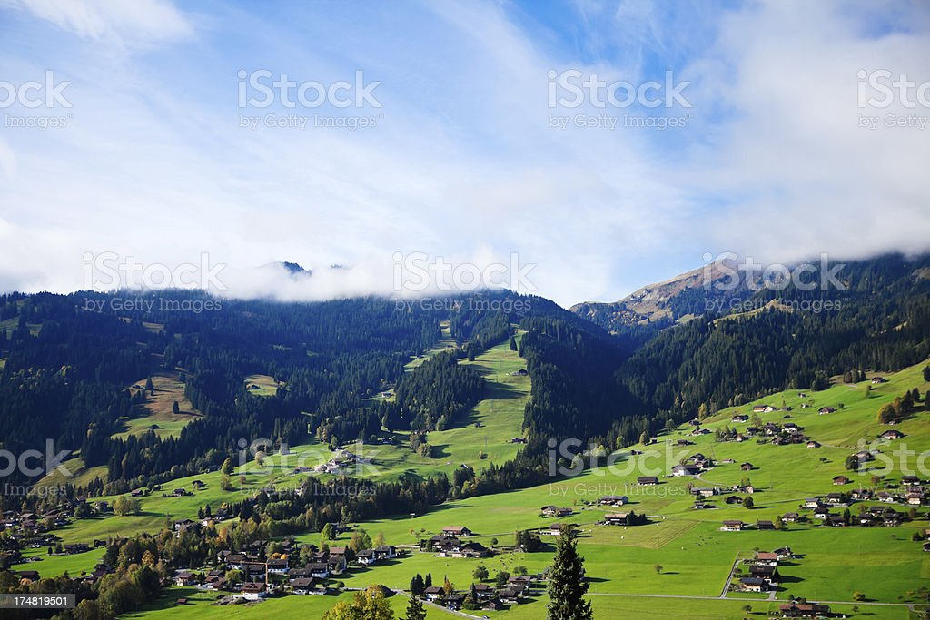 Clouds Rolling Through Swiss Alps royalty-free stock photo