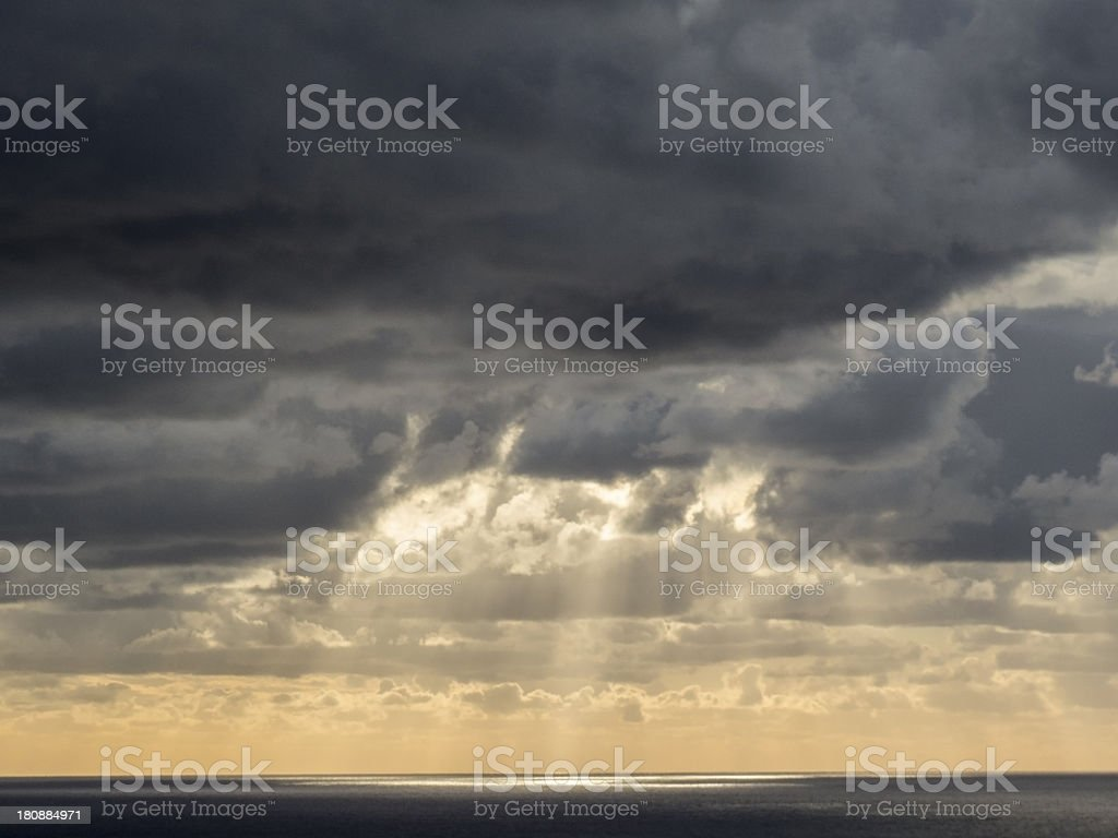 Clouds & Sun Rays over the ocean royalty-free stock photo