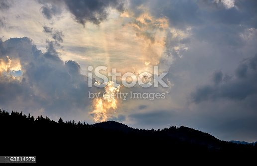 istock Clouds, sunset, beautiful color. Mountains in the foreground. 1163814273