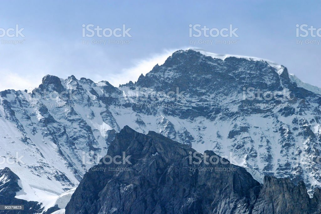 Clouds Swirling Around Mountain Top royalty-free stock photo