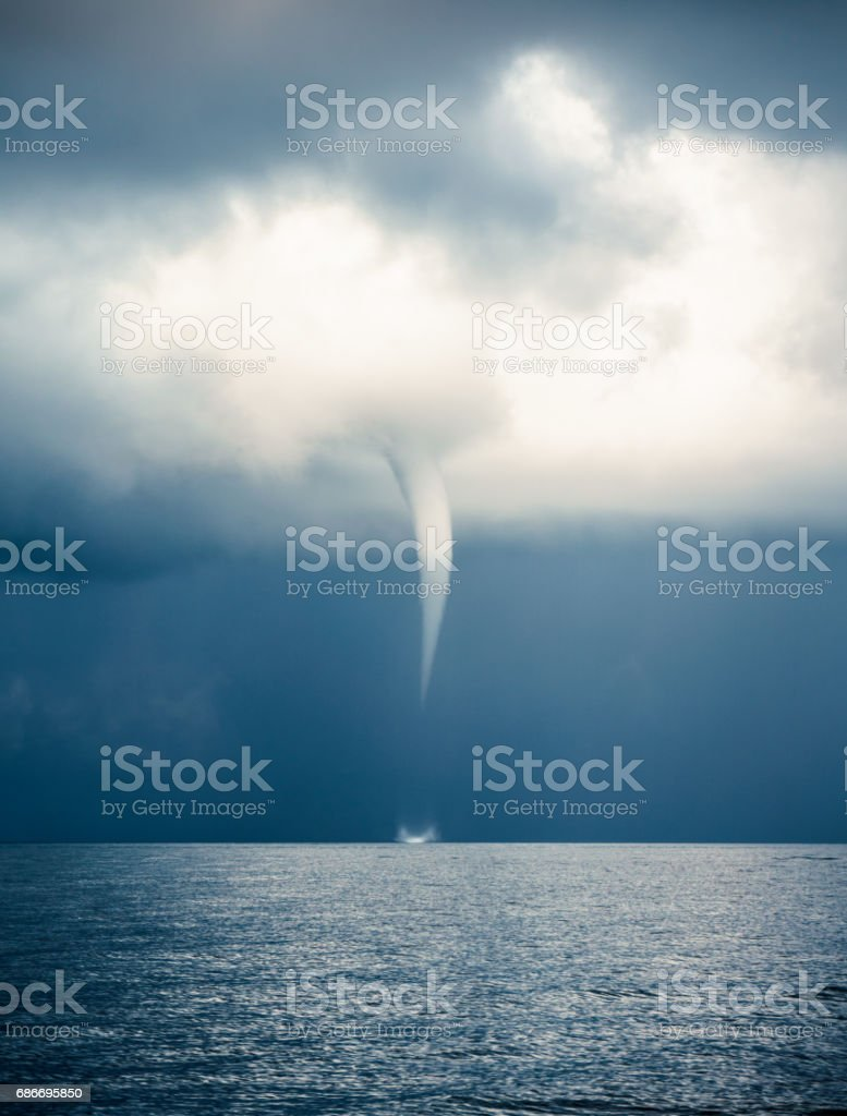 Clouds Typologies: Tornado, Hurricane, Cyclone, Typhoon, Cumulus Clouds in moody Sky during Sumer Monsoon Thunder Storm. stock photo