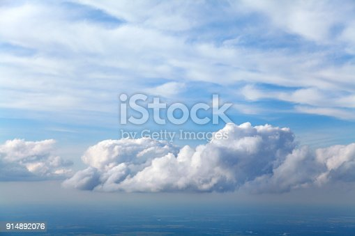 Blue and silver clouds background, view from airplane