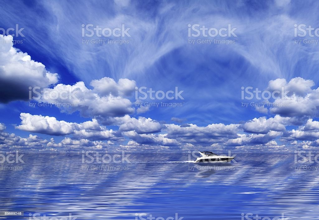 Clouds, water and a yacht stock photo