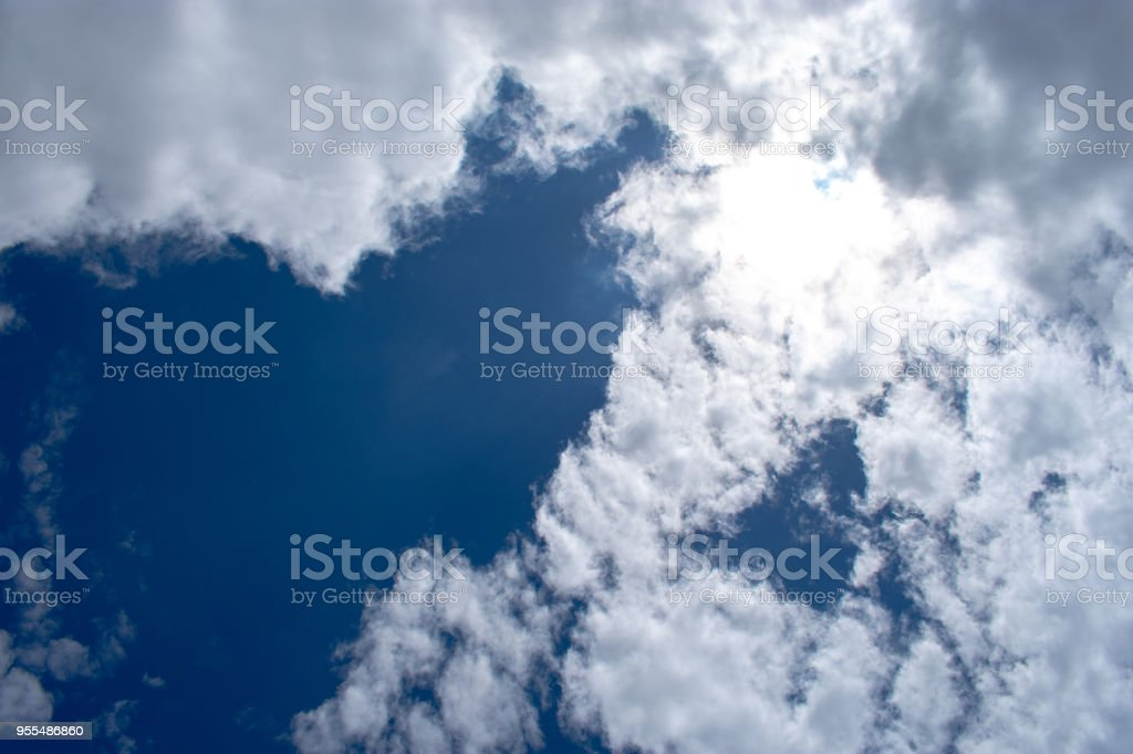 clouds with sun shining through stock photo