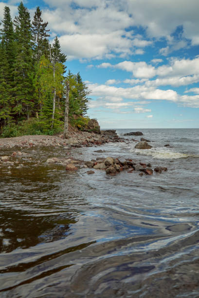 Clouds, Woods and Lake Superior Waves in Minnesota stock photo