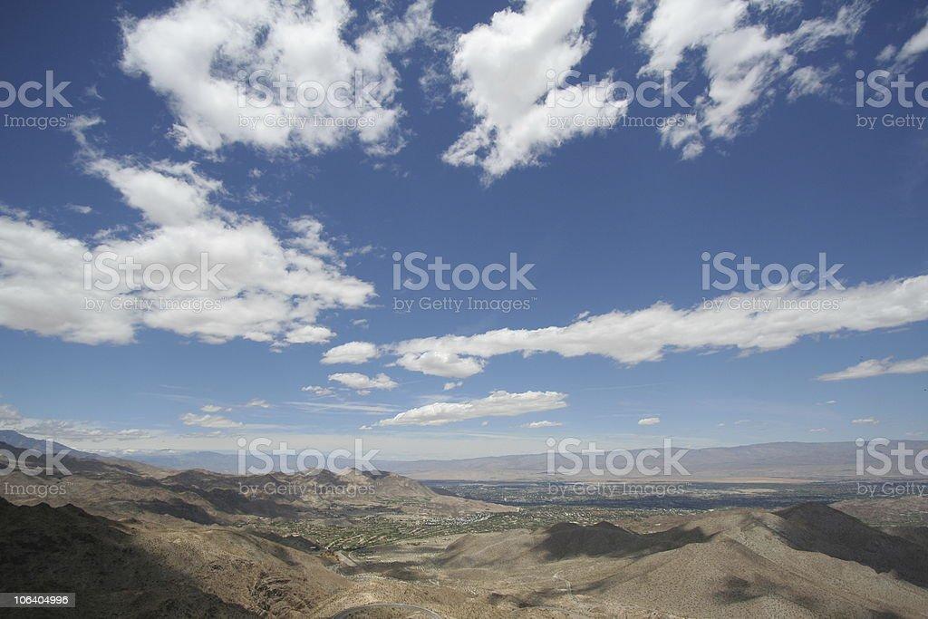 Cloudscape above desert landscape stock photo