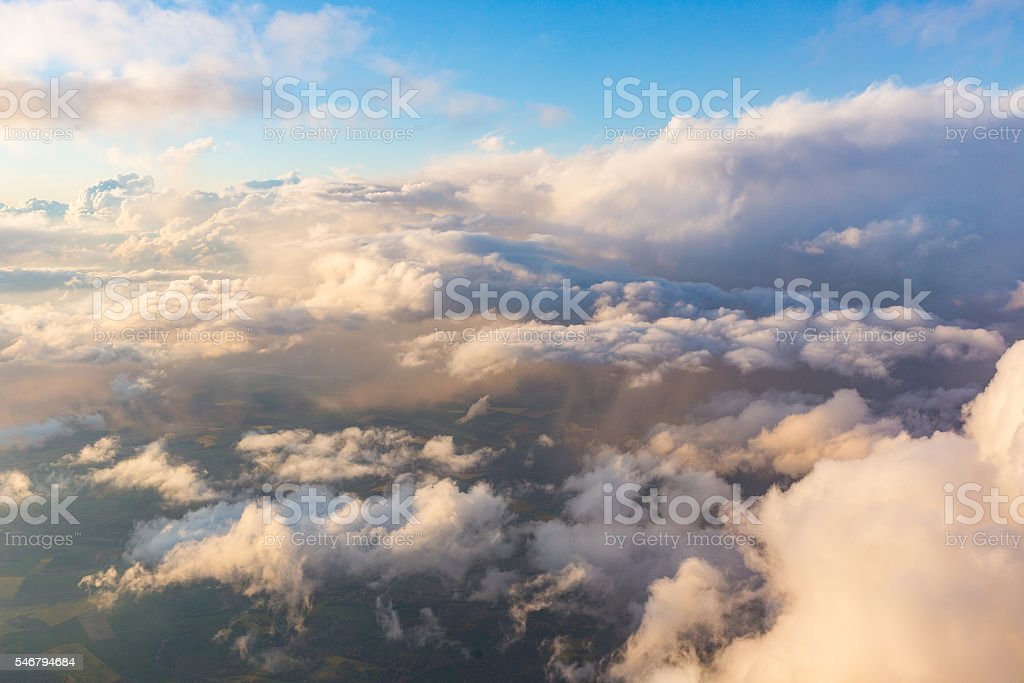 Cloudscape aerial view from airplane window seat stock photo