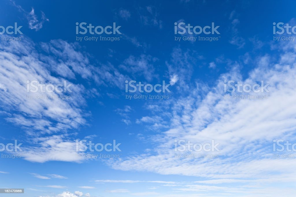 Cloudscape against deep blue sky stock photo