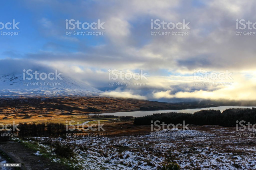 Cloudscape and Snowy Mountains of the Scottish Highlands stock photo
