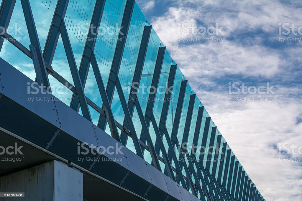 Cloudscape behind Detail Freeway Noise barrier Amsterdam IJburg stock photo