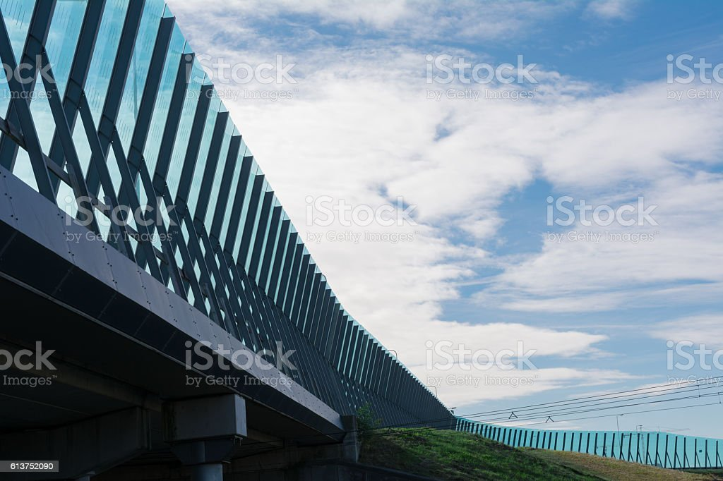 Cloudscape behind Freeway Noise barrier Amsterdam IJburg stock photo