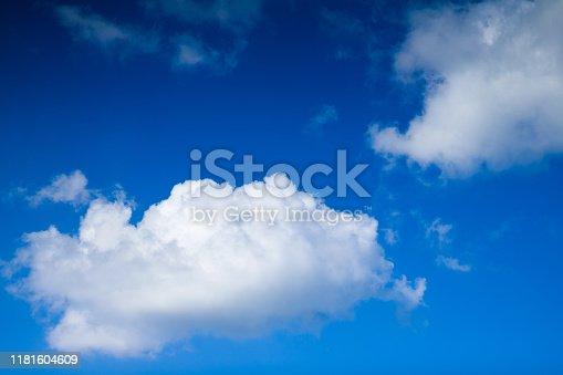 479184640istockphoto Cloudscape. Blue sky and white cloud. Sunny day. Cumulus clouds. 1181604609
