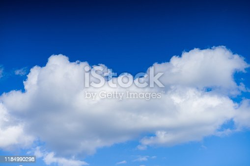 479184640istockphoto Cloudscape. Blue sky and white cloud. Sunny day. Cumulus clouds. 1184990298