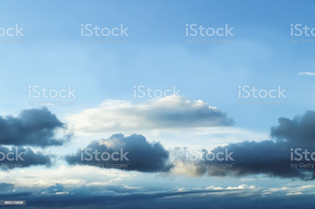Cloudscape - Blue sky with layers of clouds near the bottom as a storm forms - no land - background or room for text zbiór zdjęć royalty-free
