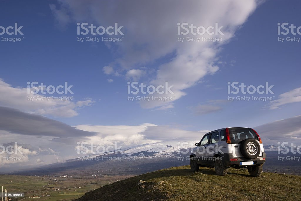 cloudscape for one vehicle off-road stock photo