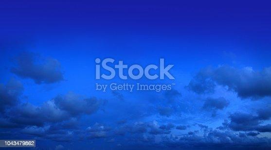 istock Cloudscape image of blue night sky 1043479862