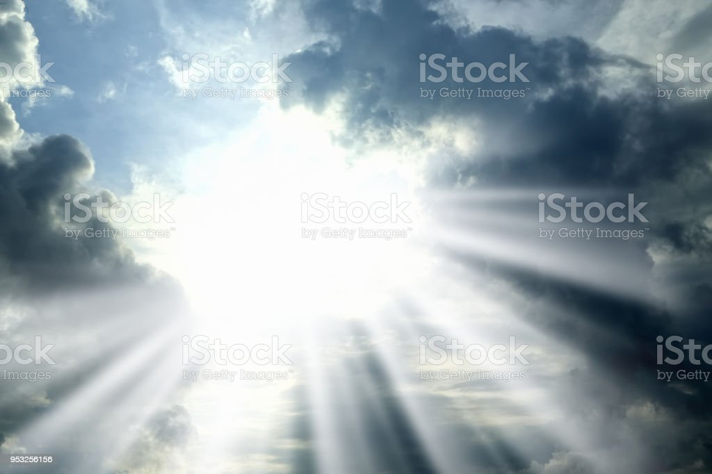 Cloudscape image of dramatic sky with storm clouds and sunbeam stock photo