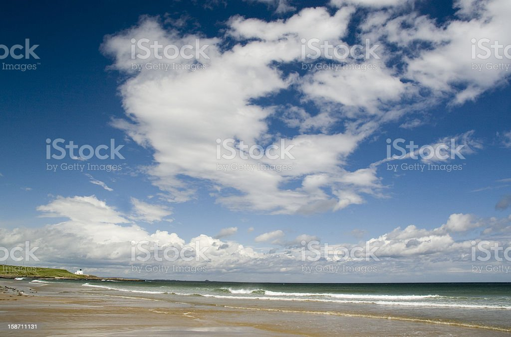 Cloudscape on a Northumberland Beach royalty-free stock photo